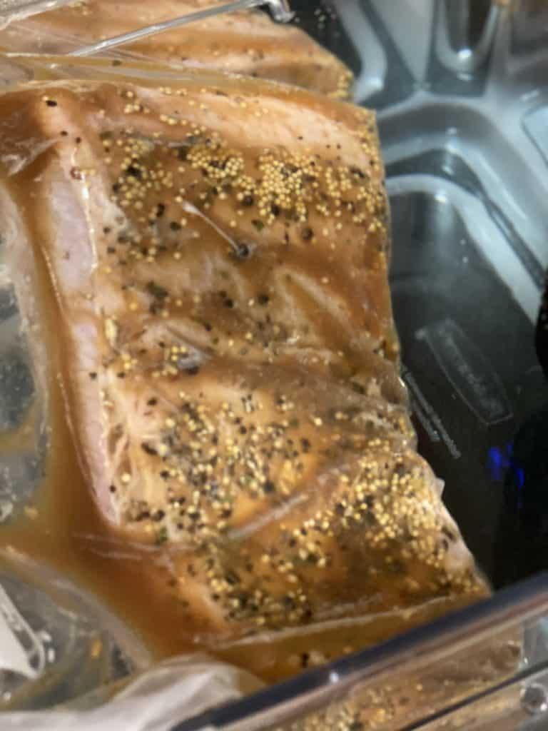 brisket in a ziploc bag in a water bath for sous vide corned beef