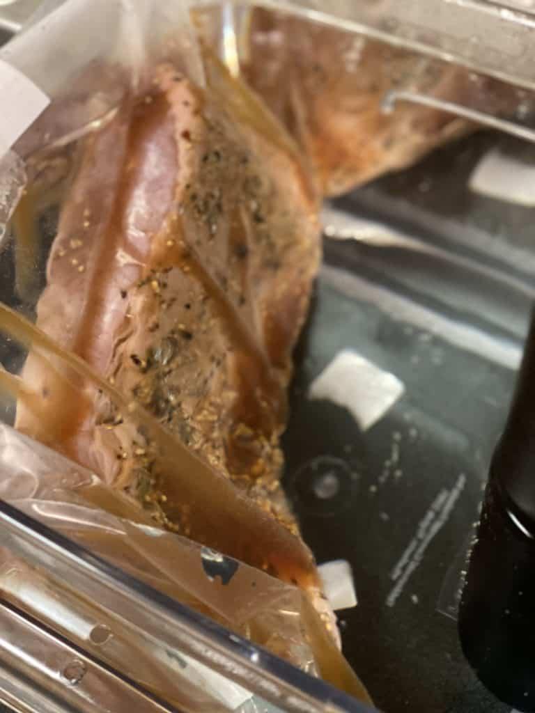 brisket in a ziploc bag in a water bath