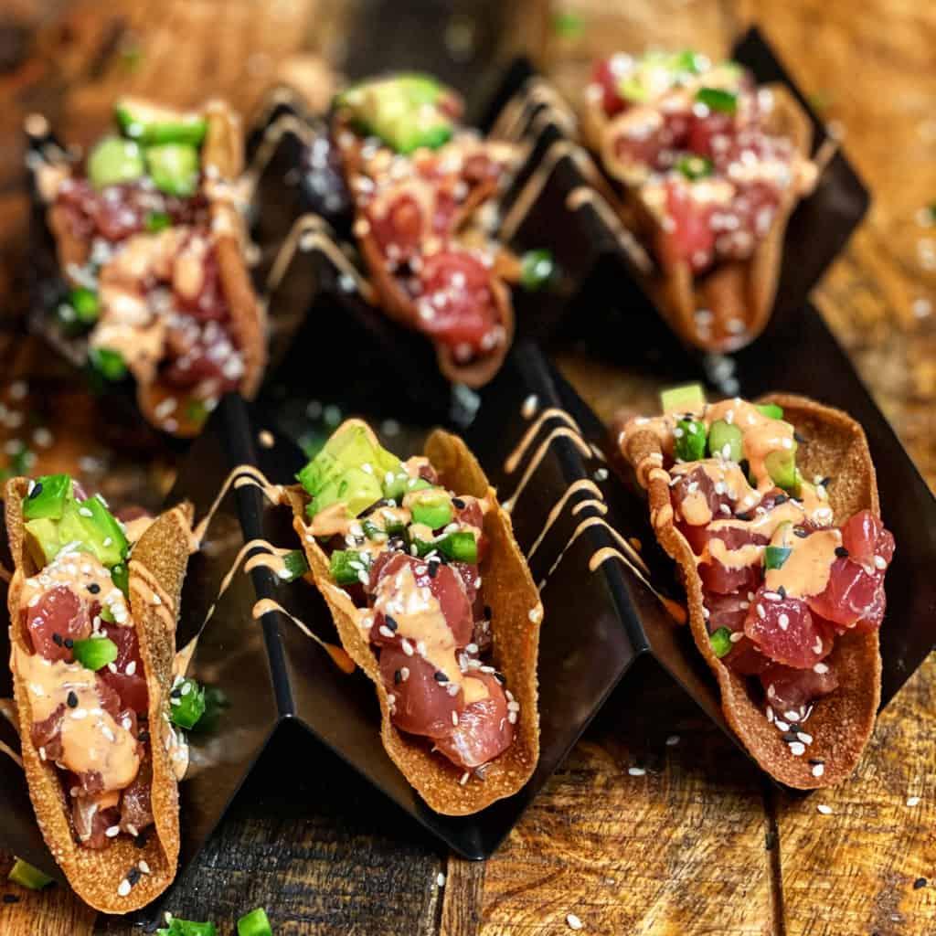 six wonton tuna tacos in a taco stand