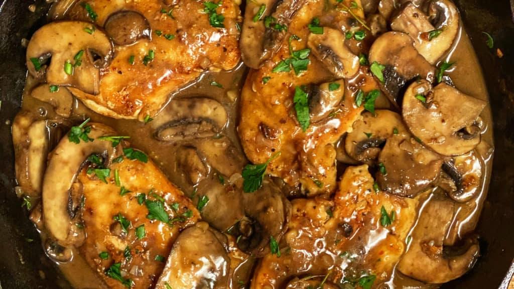 a cast iron pan of chicken marsala