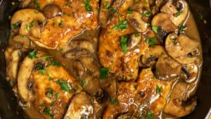 a cast iron pan of chicken marsala