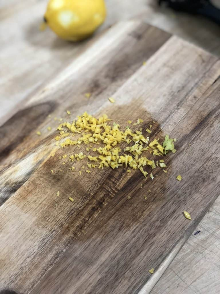 lemon zest on a wooden board