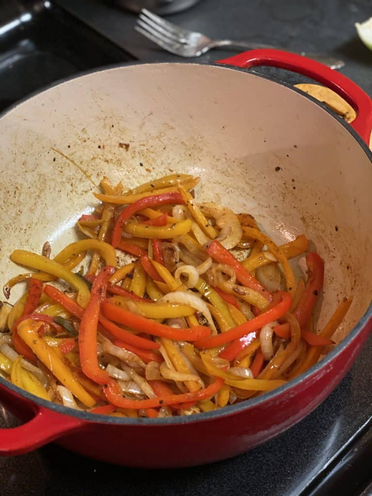 peppers coated with spice in a cast iron pan