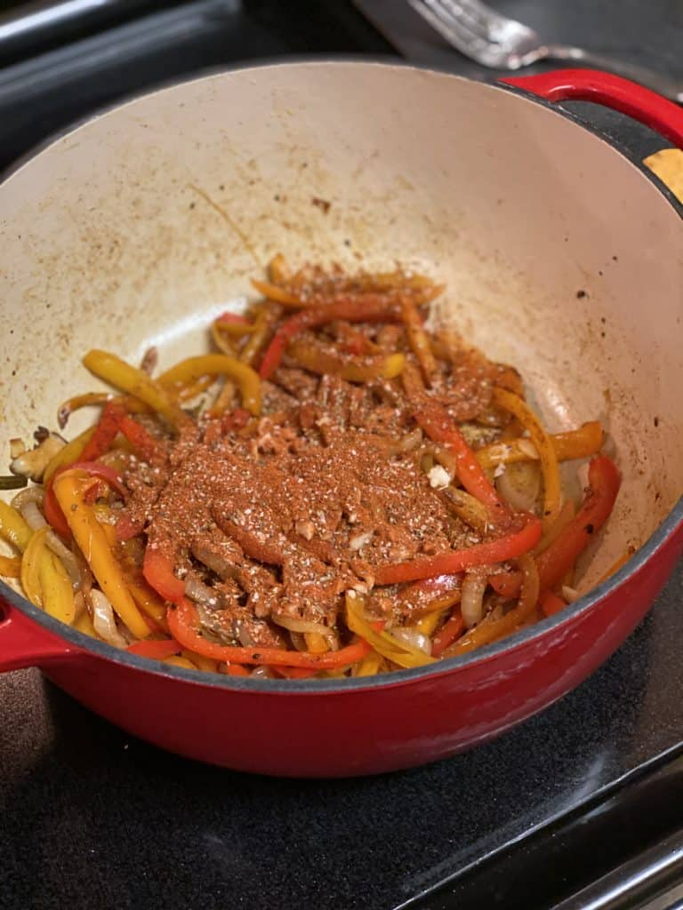 peppers and onions caramelized in a cast iron pot