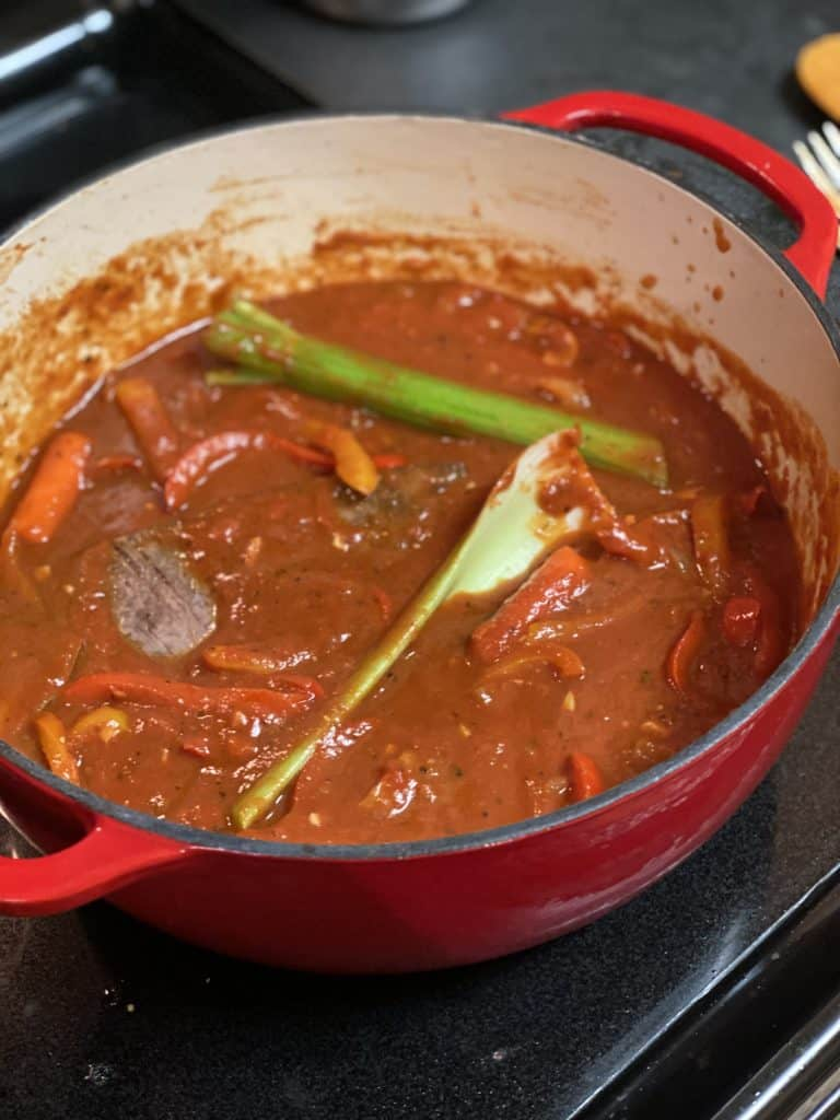 ropa vieja sauce in a cast iron pot