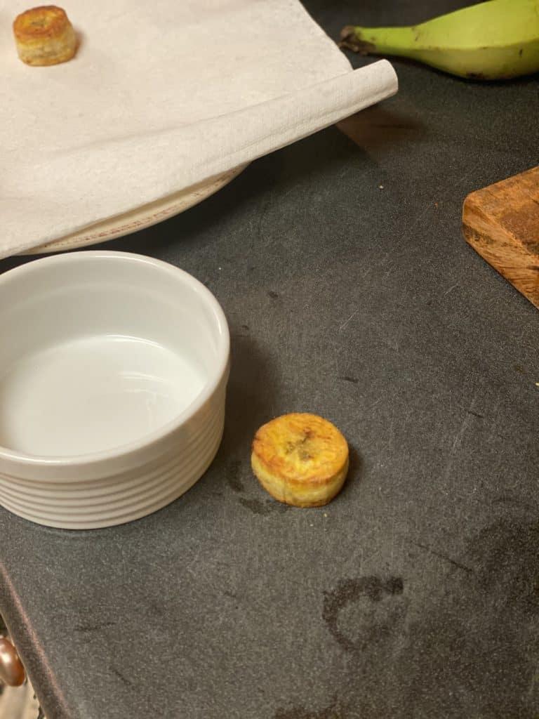 one plantain next to a white bowl