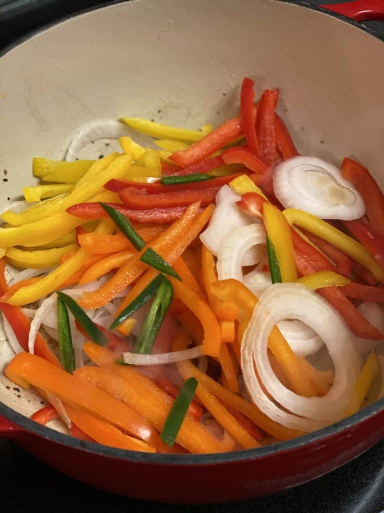 peppers and onions in a cast iron pot