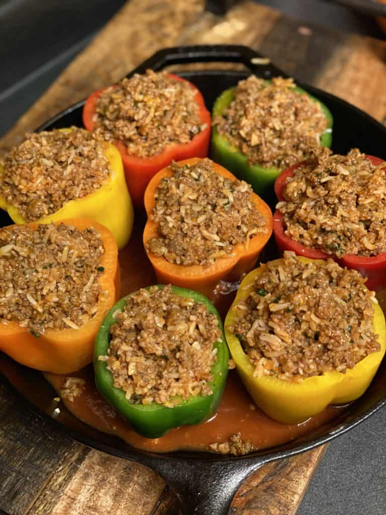 eight colored stuffed bell peppers stuffed with sausage mixture