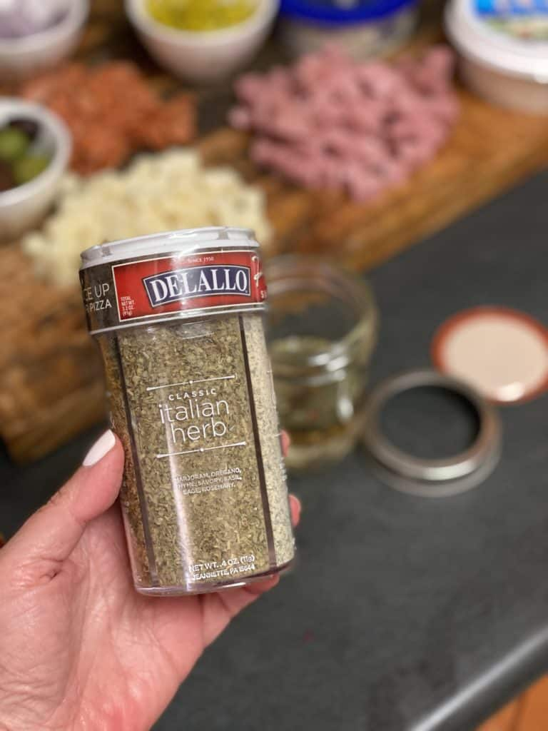a jar of Delallo Italian herb blend seasoning