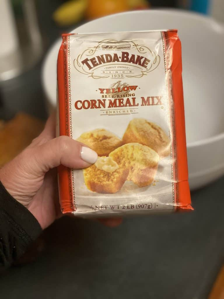 me holding a bag of Tenda Bake yellow cornmeal