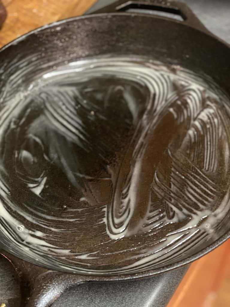 a cast iron pan lined with butter