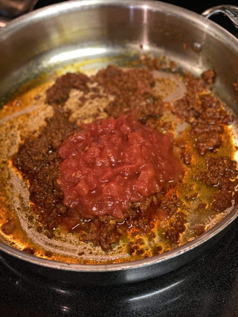 a pan of chorizo and crushed tomatoes