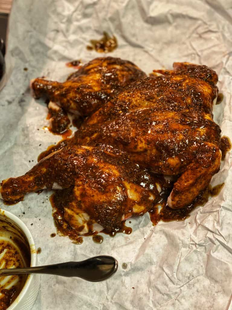 spatchcocked chicken rubbed with an African spice blend