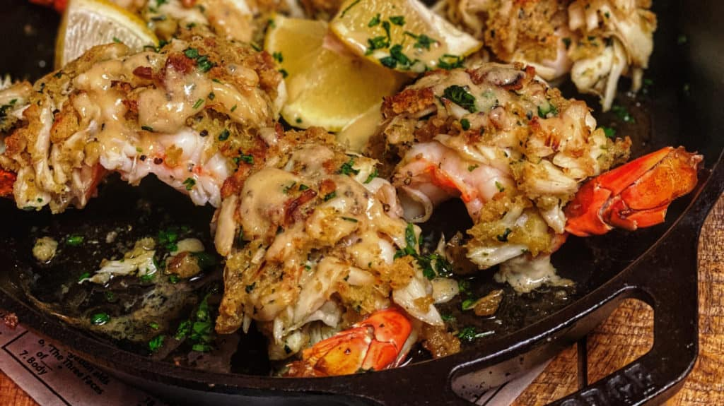 a cast iron pan of crab stuffed shrimp