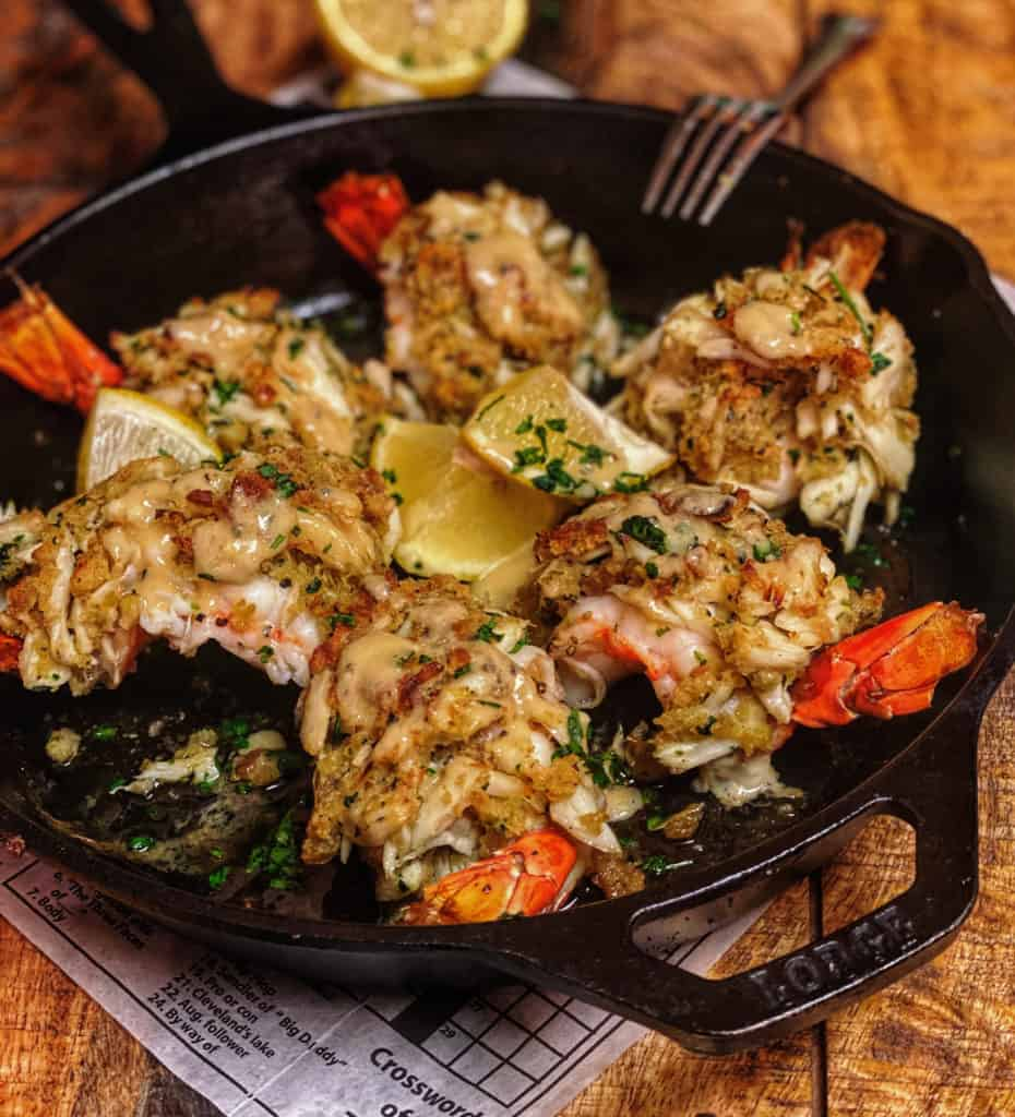 a cast iron pan of crab stuffed shrimp