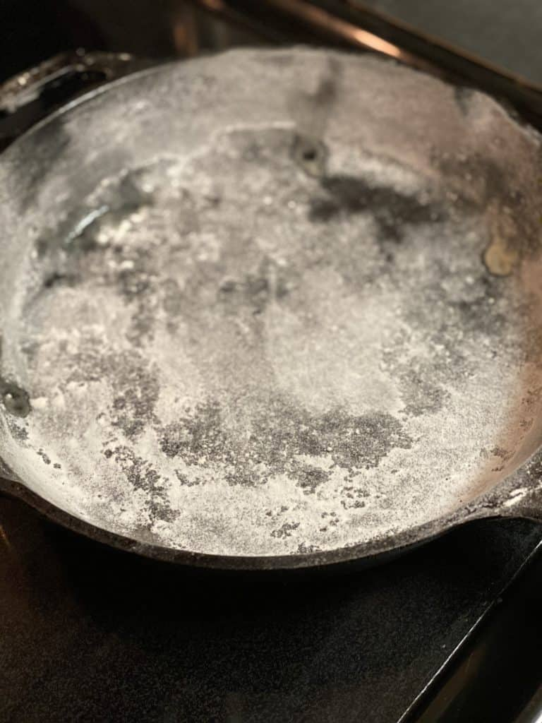 cast iron skillet lined with cooking spray and flour