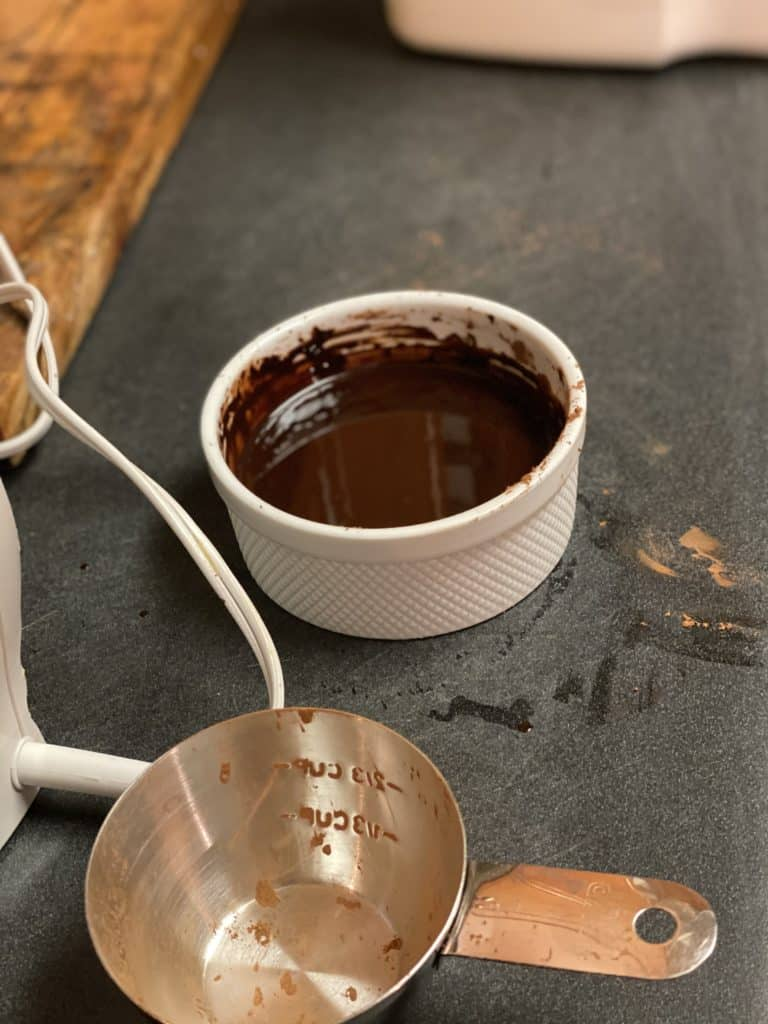 oil and cocoa powder mixed in a bowl for homemade fudge brownies