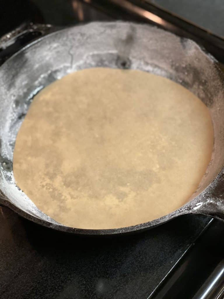 cast iron pan lined with parchment paper