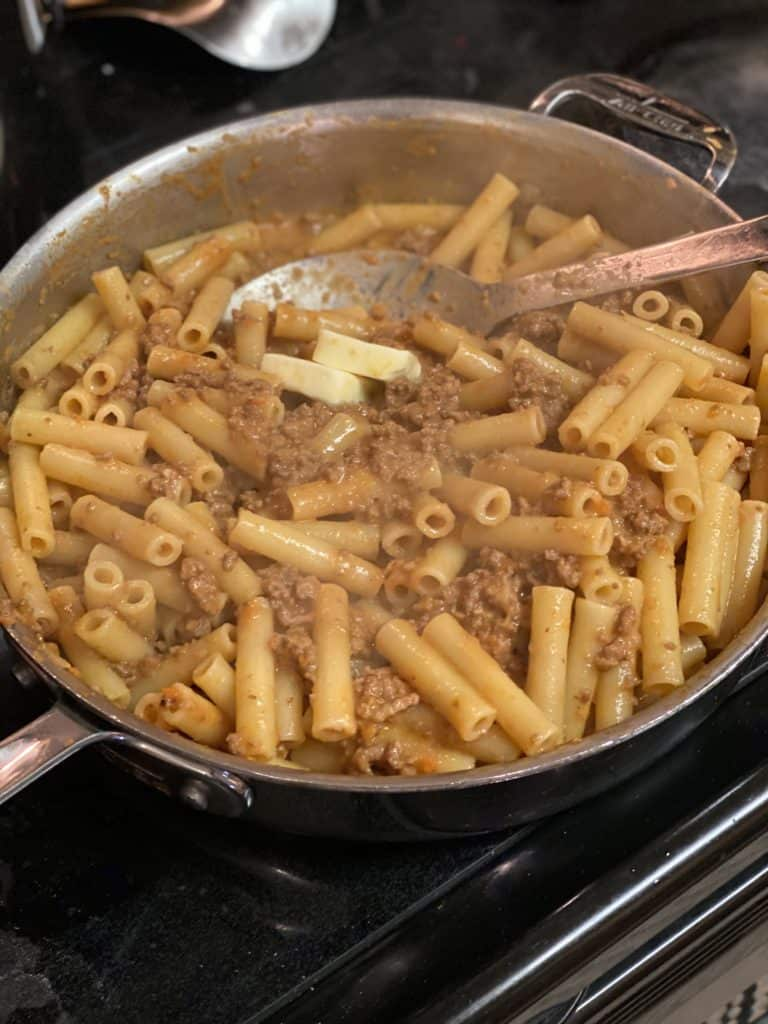 pasta in a bolognese sauce with a few tablespoons of butter