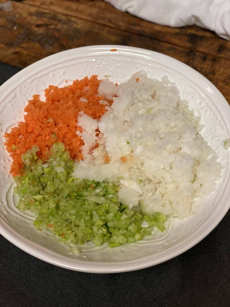 minced carrots, celery and onions in a white bowl