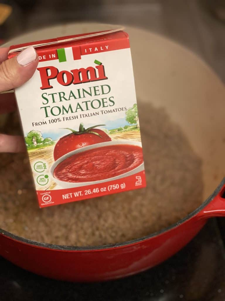 a box of Pomi strained tomatoes