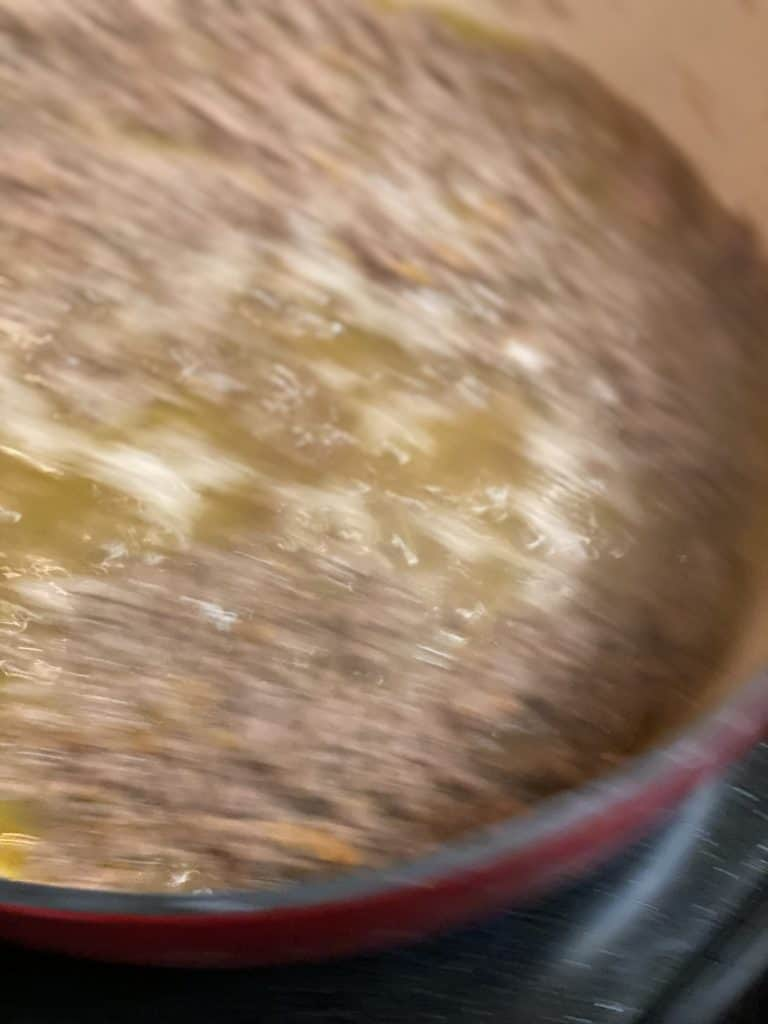 wine in ground meat mixture in a pot