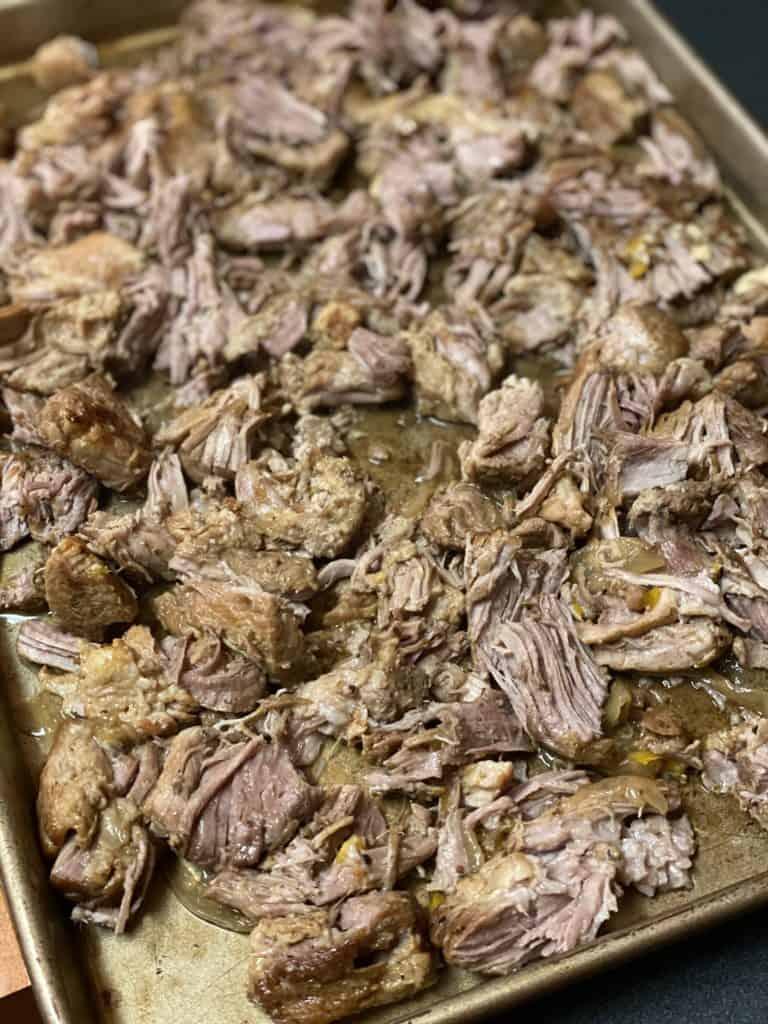 slow cooked pork shoulder shredded on a baking pan