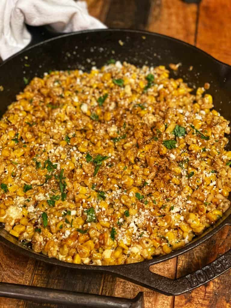 Mexican corn salad in a cast iron pan