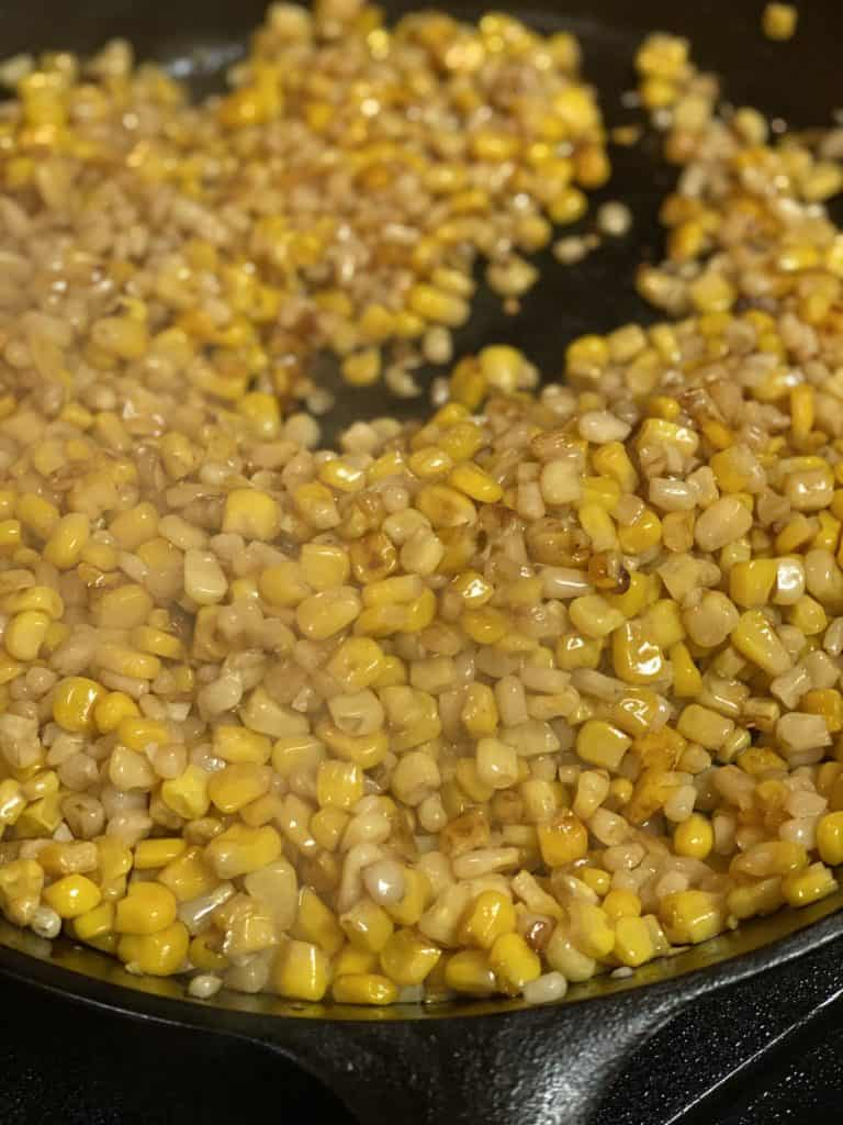 corn browned up in a cast iron pan with butter