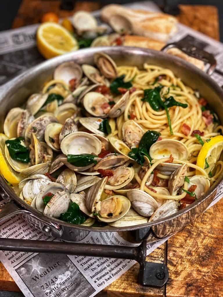 bucatini with clams in a pan