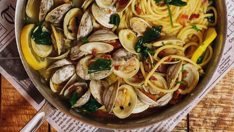 a pan of bucatini with clams