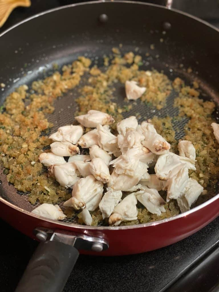 jumbo lump crab in a pan with breadcrumb mixture for crab stuffed shrimp