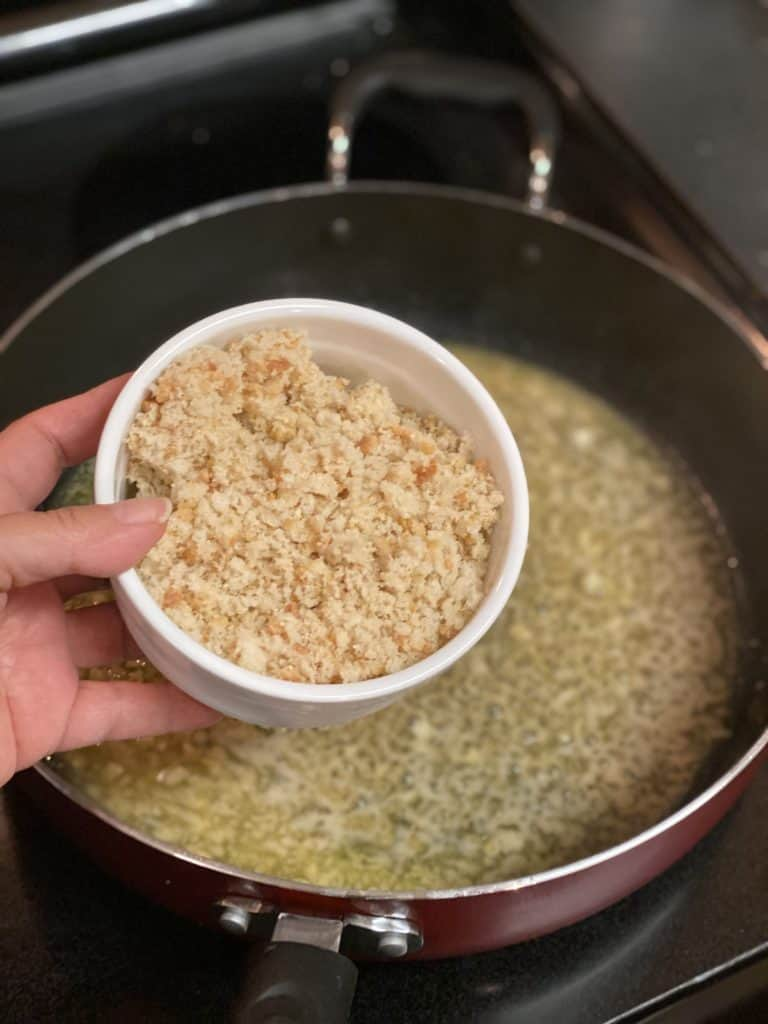 a white bowl of homemade breadcrumbs