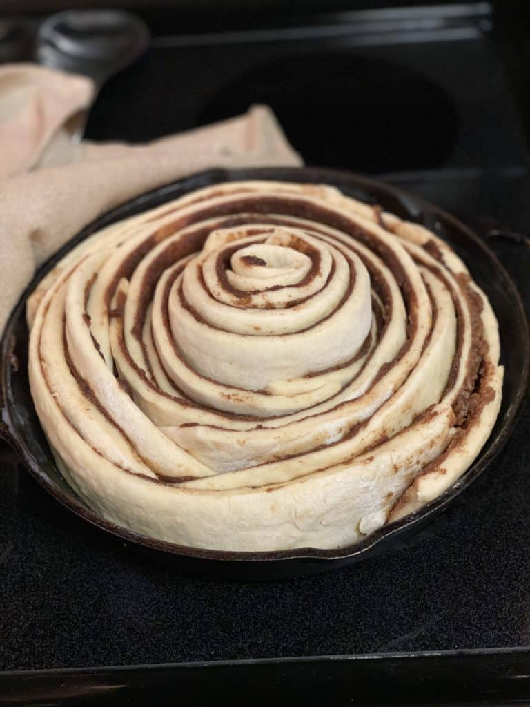 cast iron cinnamon roll ready to bake