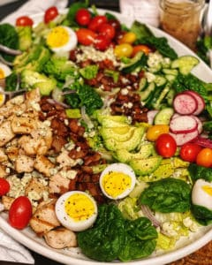Cobb Salad with Vinaigrette on a white platter