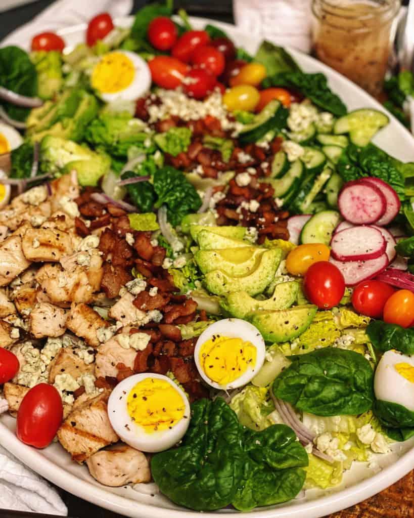 Cobb Salad with Vinaigrette on a white platter