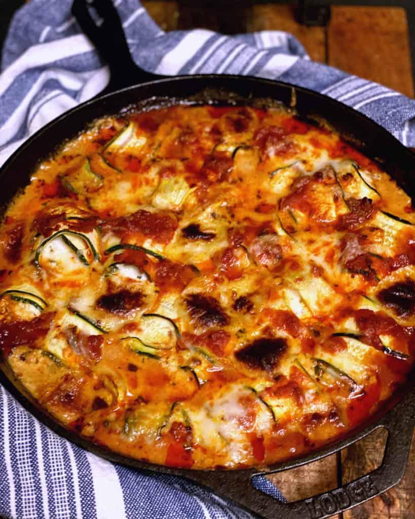 zucchini rollatini in a cast iron pan