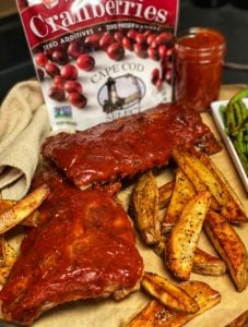 two racks of ribs with cranberry barbecue sauce