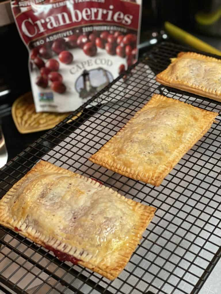 cranberry ricotta pop tarts cooling on rack