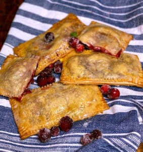 cranberry ricotta pop tarts on a blue and white cloth