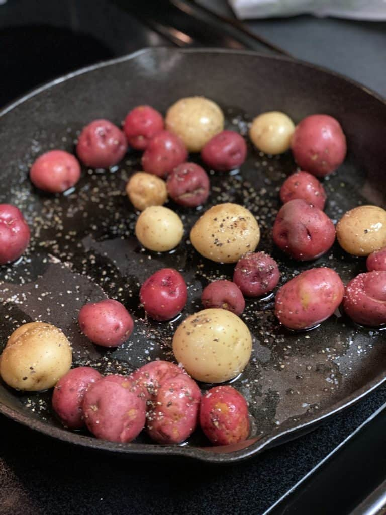 creamer potatoes in a cast iron pan
