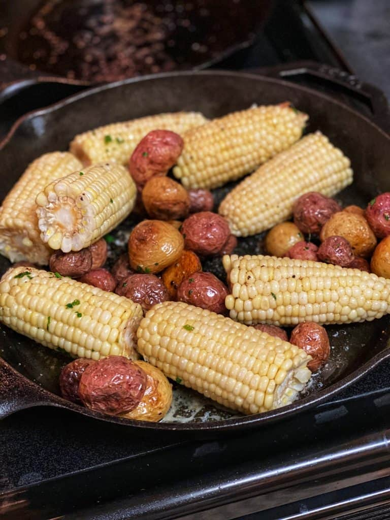 corn and potatoes in a cast iron pan