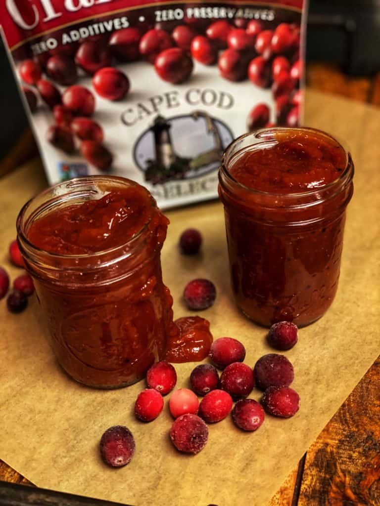 two mason jars filled with cranberry barbecue sauce
