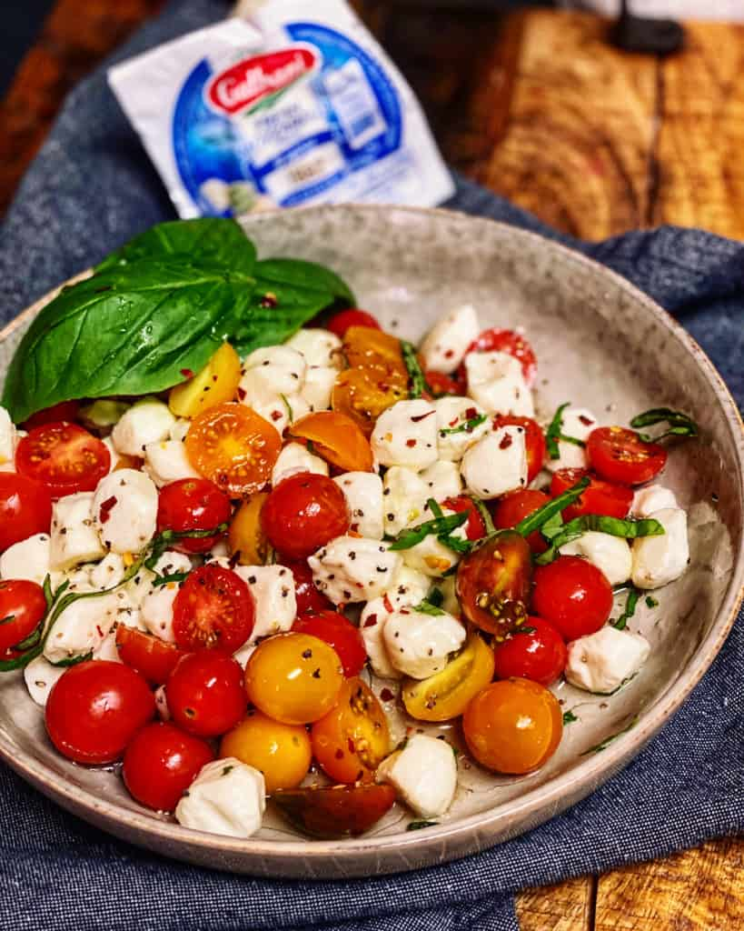 heirloom cherry tomato caprese salad with a package of Galbani cheese