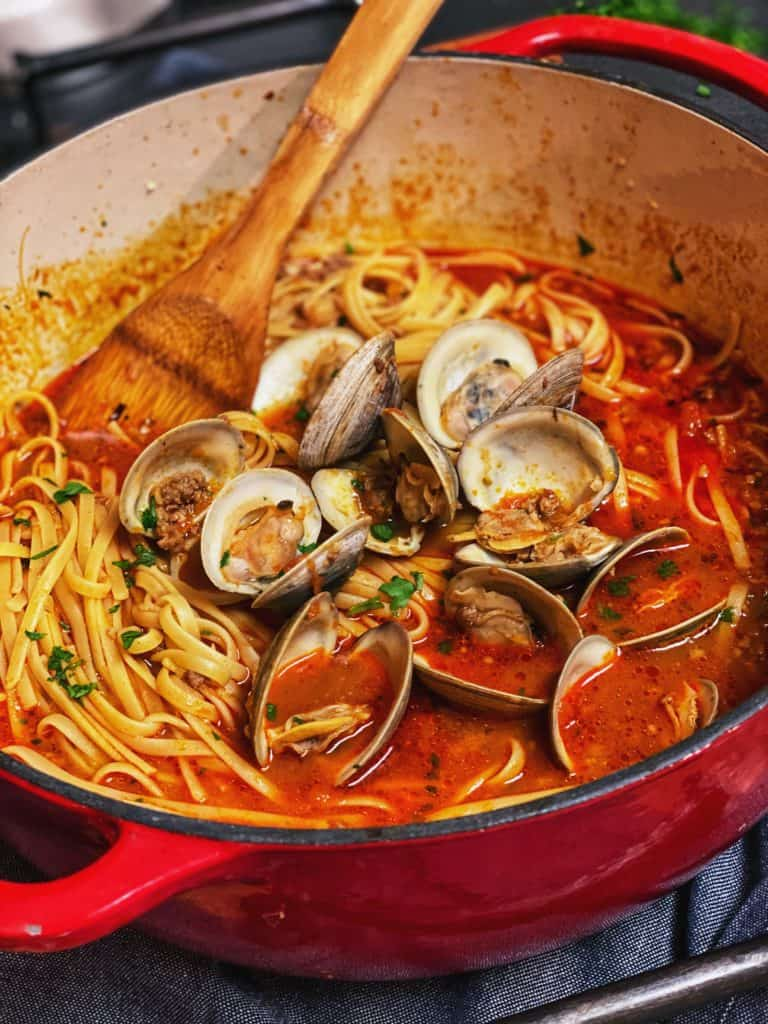sauce for linguine with red clam sauce in a red pot