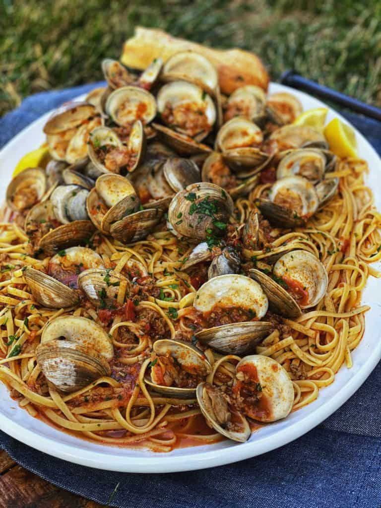 linguine with red clam sauce on a white platter