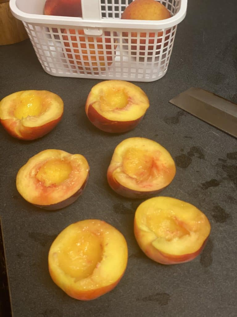 three peaches halved and pitted