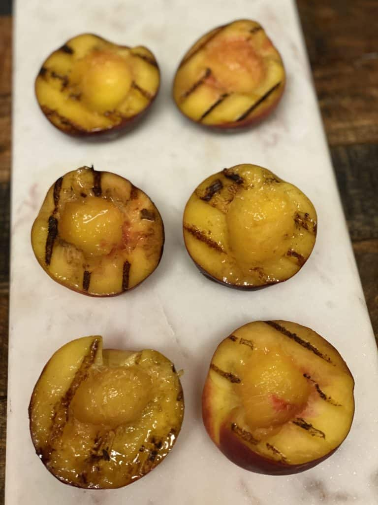 grilled peach halves ready for the apricot jam browned butter