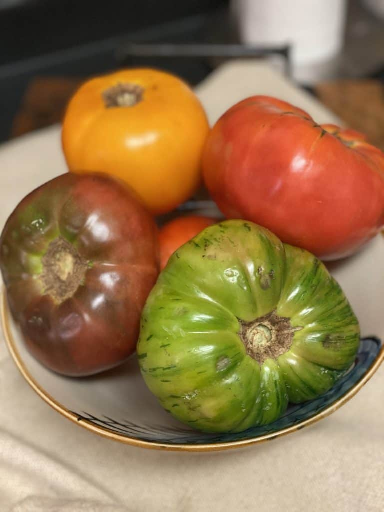 a bowl of heirloom tomatoes