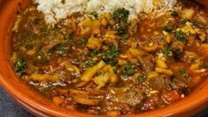 Mediterranean lamb tagine with apricots in a clay pot with rice